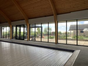 Swimming pool fitted with one-way, reflective window film in Leicester