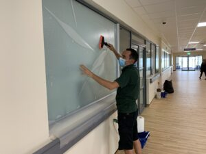 Applying privacy window films in NHS hospitals during coronavirus pandemic