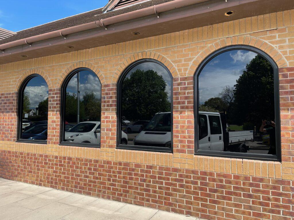 window tinting installation at Derby restaurant